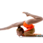 Attractive gymnast athlete teenage girl wearing dancer colorful leotard working out, dancing, posing, doing art gymnastics, backbend acrobatic exercise, full length, studio, white background, isolated